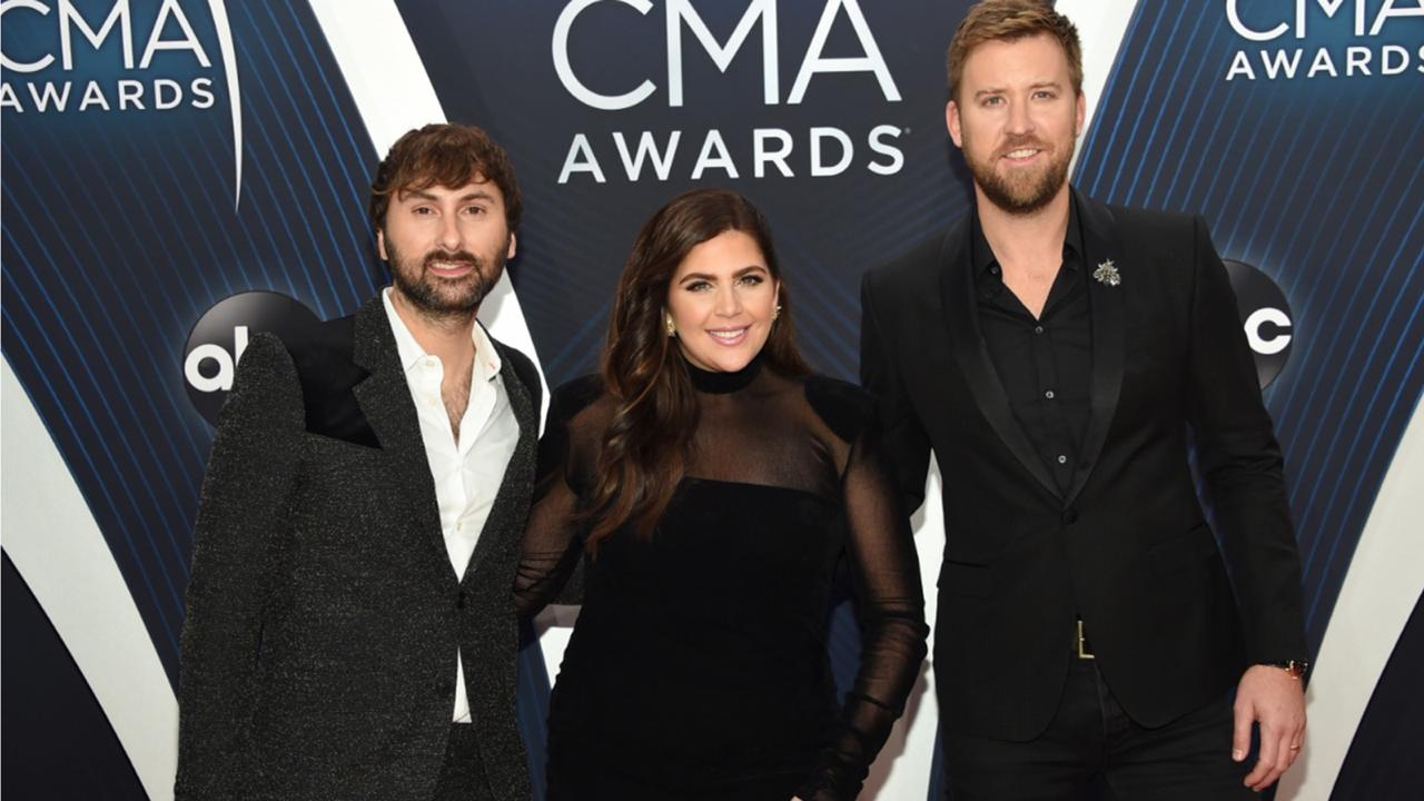 "In this Nov. 14, 2018 file photo, Dave Haywood, from left, Hillary Scott and Charles Kelley, of Lady A, formerly Lady Antebellum, arrive at the 52nd annual CMA Awards in Nashville, Tenn. The Grammy-winning country group, which dropped the word ""Antebellum"" from their name because of the word's ties to slavery, has filed a lawsuit against a Black singer who has used the stage name for years."