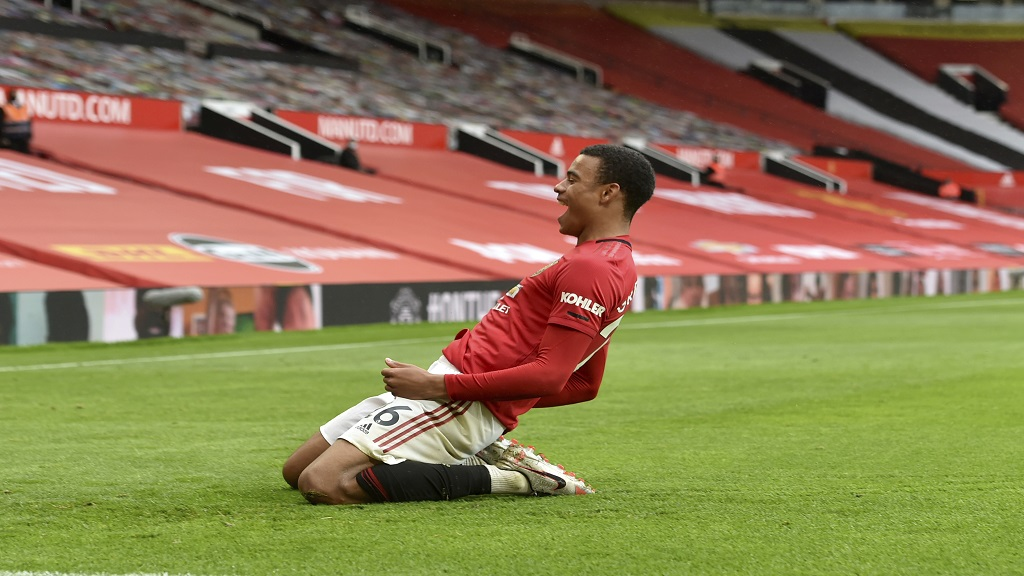 Manchester United's Mason Greenwood celebrates after scoring a goal during the English Premier League football match against Bournemouth at Old Trafford stadium in Manchester, England, Saturday, July 4, 2020. (Peter Powell/Pool via AP).