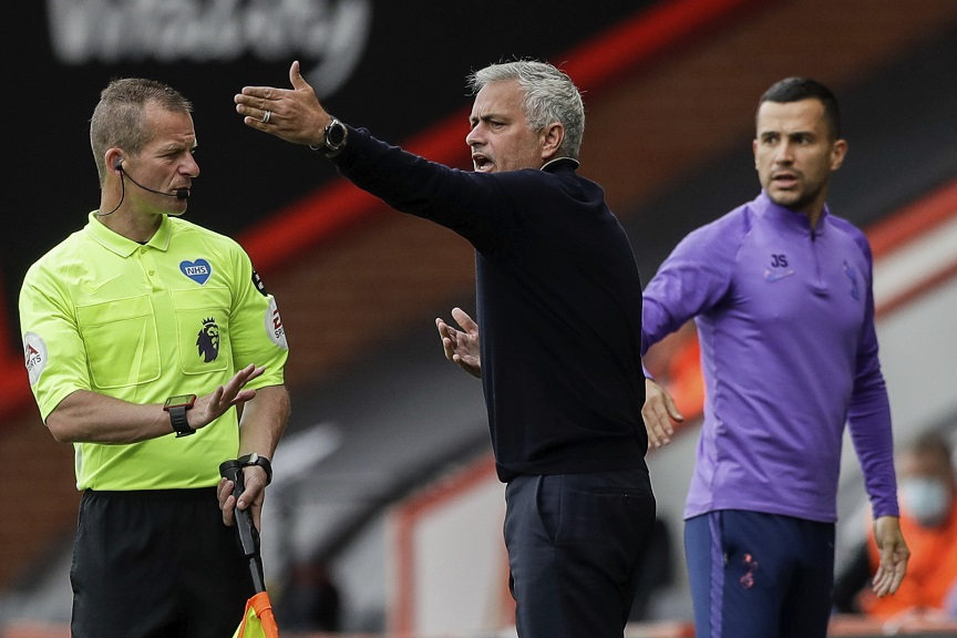 Tottenham's manager Jose Mourinho, centre, gestures during the English Premier League football match against Bournemouth at the Vitality Stadium in Bournemouth, England, Thursday, July 9, 2020. (AP photo/Matt Dunham, Pool).