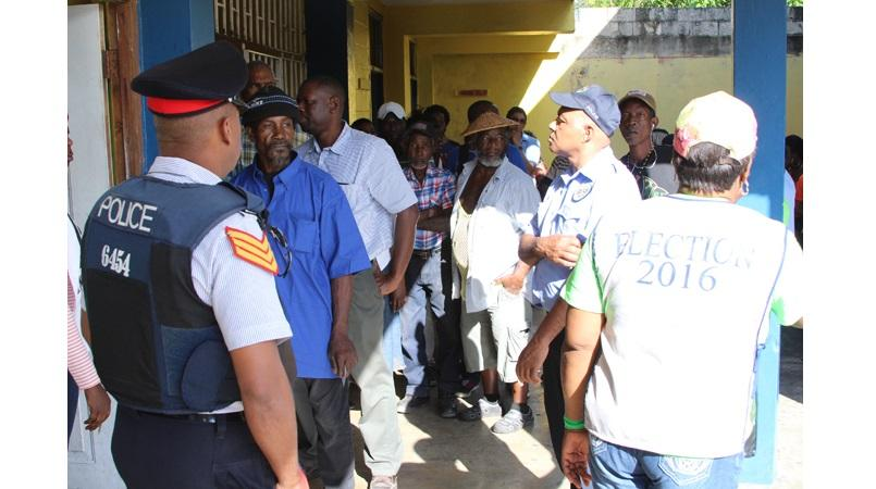 In this file photo from the 2016 general election, voters queue at a polling station in West Rural St Andrew.