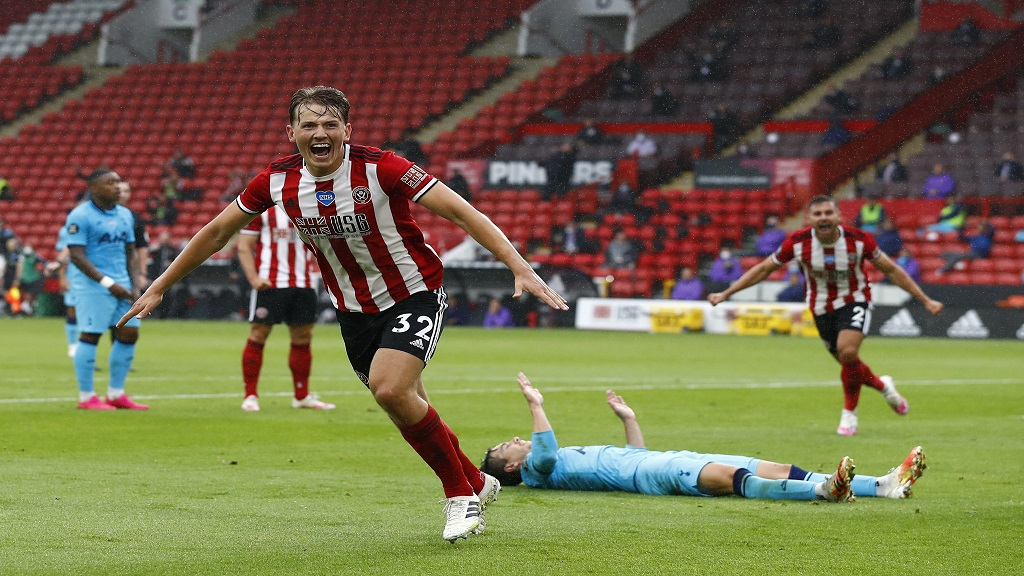 Sheffield United's Sander Berge celebrates after scoring the opening goal during the English Premier League football match against Tottenham at Bramall Lane in Sheffield, Thursday, July 2, 2020. (Jason Cairnduff/Pool via AP).