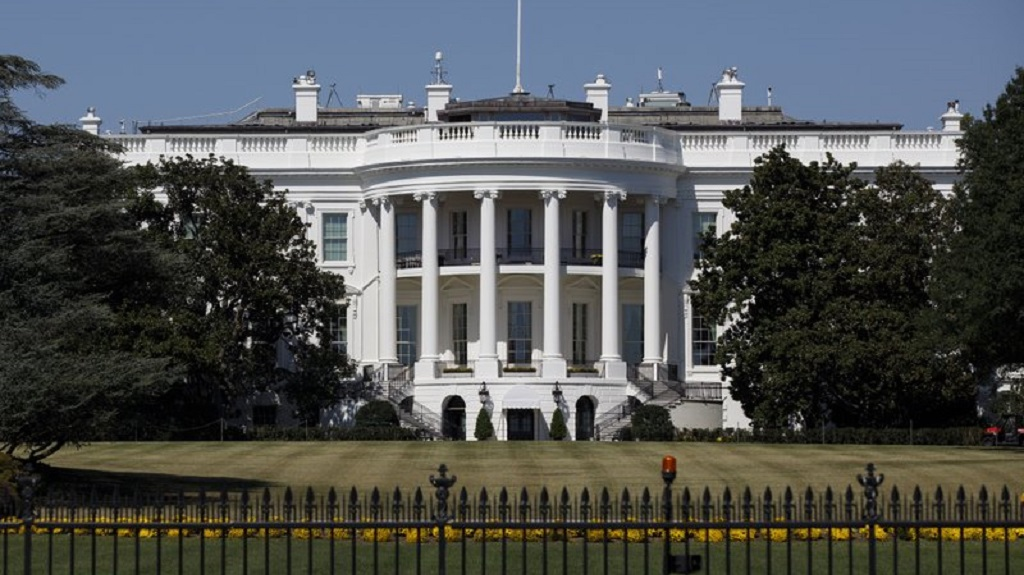 FILE - In this Sept. 25, 2019, file photo, The White House is seen from the Ellipse in Washington. Forty lobbyists with ties to President Donald Trump helped their clients secure over $10 billion in federal coronavirus aid. Among them are five former administration officials whose lobbying work potentially violates an ethics order Trump issued after taking office. (AP Photo/Carolyn Kaster, File)