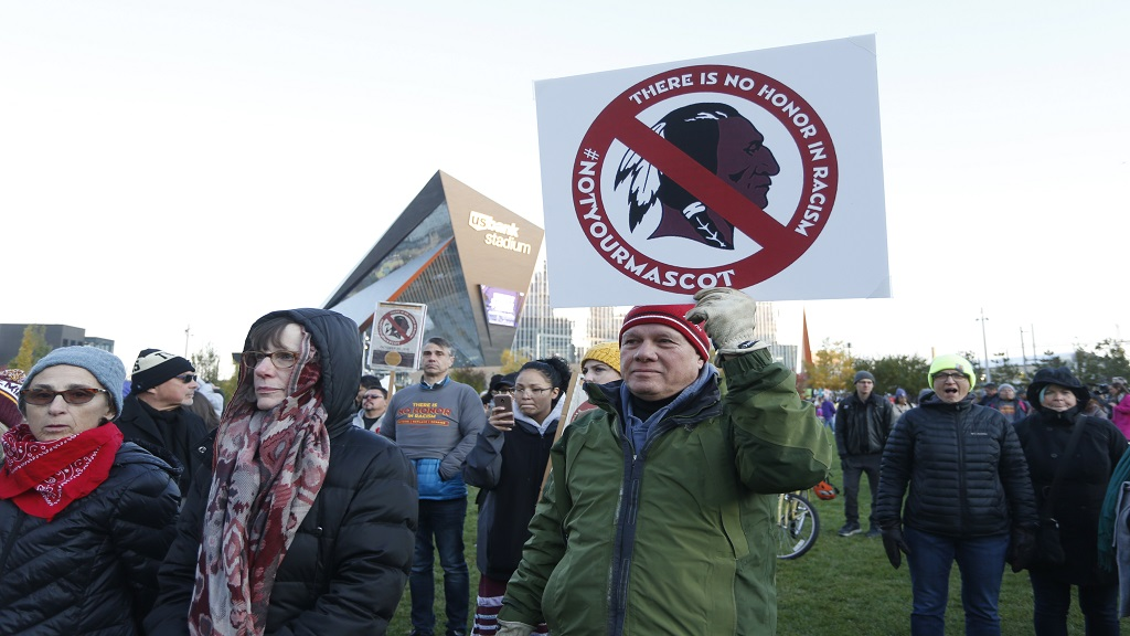 FILE - In this October 24, 2019, file photo, Native American leaders protest against the Redskins team name outside US Bank Stadium before an NFL football game between the Minnesota Vikings and the Washington Redskins in Minneapolis. (PHOTO: AP)