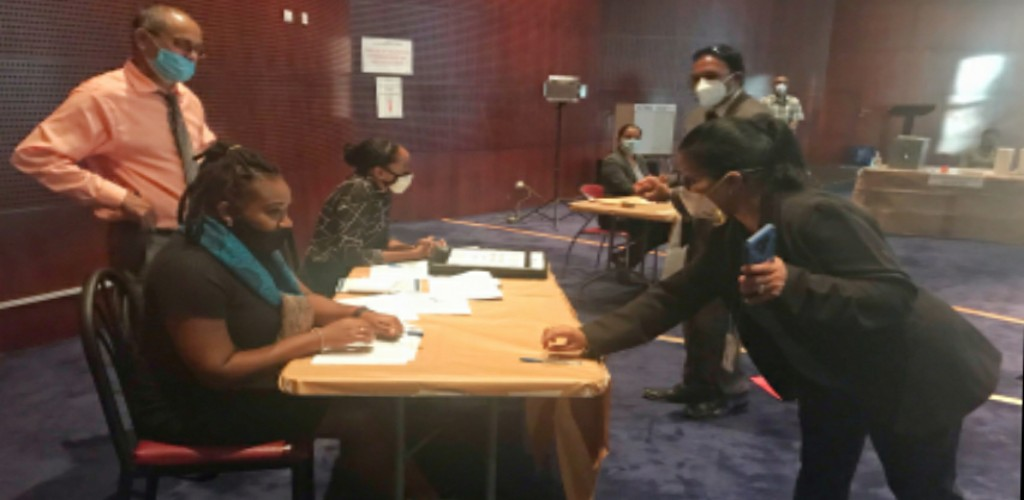 File photo via Elections and Boundaries Commission (EBC): EBC staff and health officials take part in the simulation exercise of the EBC's 'mock polling station' on June 7