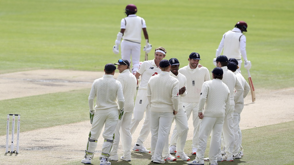 England's Stuart Broad, third left, celebrates with teammates the dismissal of West Indies' Kraigg Brathwaite during the fifth day of the deciding third cricket Test match at Old Trafford in Manchester, England, Tuesday, July 28, 2020. (Martin Rickett/Pool via AP).
