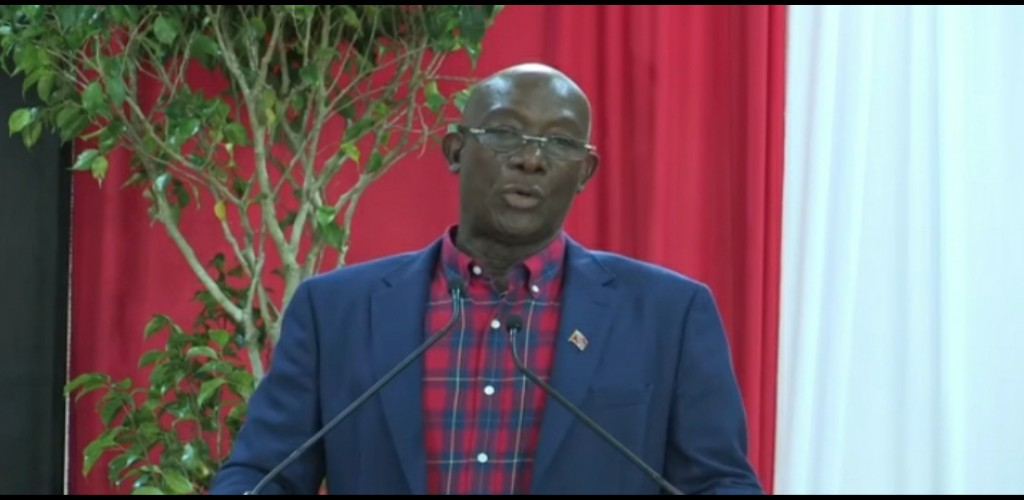 Prime Minister Dr Keith Rowley speaks during the launch of the Petrotrin Land Distribution Programme at the Palo Seco Government Primary School on July 15.