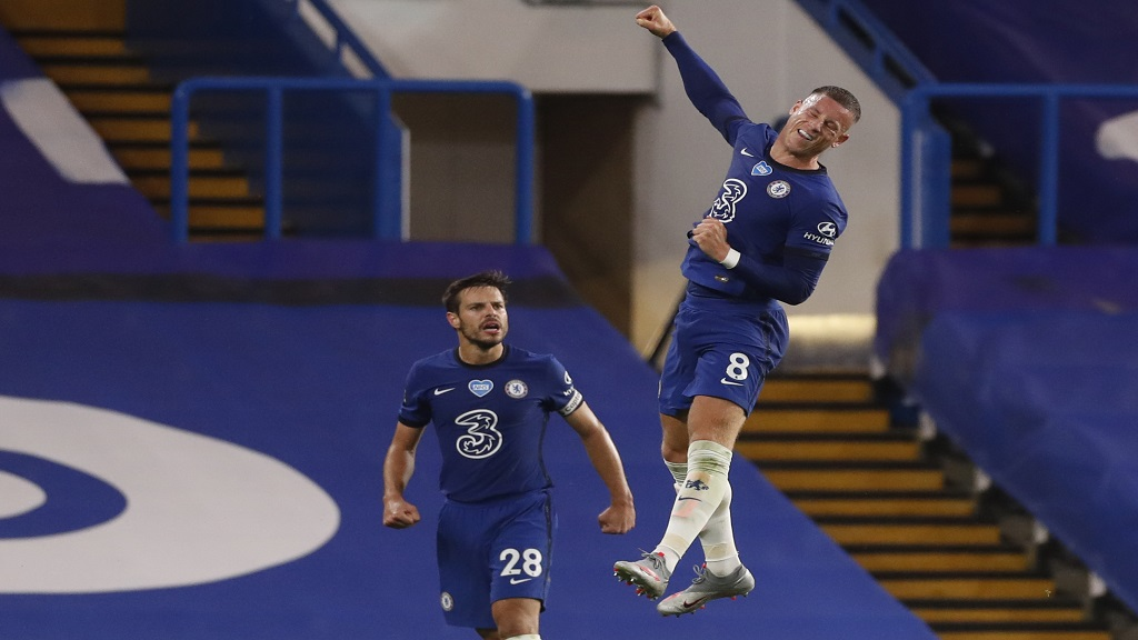 Chelsea's Ross Barkley, right, celebrates after scoring his side's third goal during the English Premier League football against Watford at the Stamford Bridge stadium in London, Saturday, July 4, 2020. (Matthew Childs/Pool via AP).