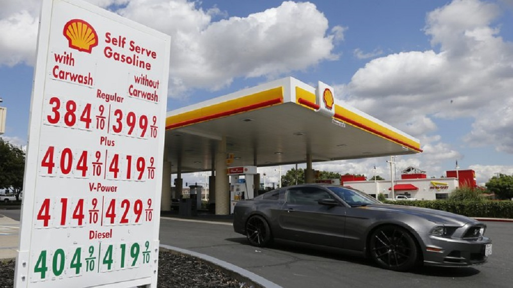 FILE - In this May 17, 2019, file photo, a car leaves a Shell station after getting gas in Sacramento, USA. Royal Dutch Shell said Thursday July 30, 2020, that its second-quarter earnings plunged 82% as the COVID-19 global pandemic slashed energy prices and demand. (AP Photo/Rich Pedroncelli, File)