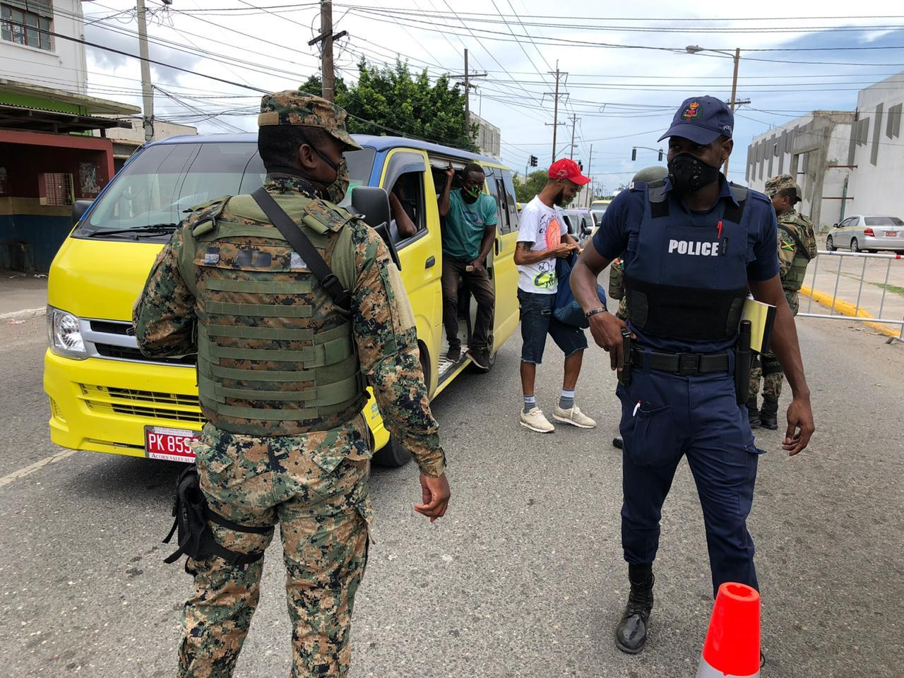 Members of the security forces at a check point in west Kingston after the area was declared a state of emergency recently.