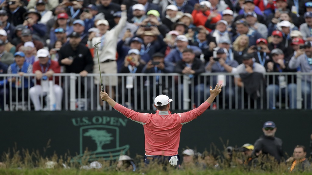 In this June 16, 2019, file photo, Gary Woodland celebrates in front of fans after winning the US Open golf tournament in Pebble Beach, Calif. The USGA announced Wednesday, July 29, 2020, that no fans will be allowed at Winged Foot in New York on Sept. 17-20 for the US Open, noting that the decision was based on health and safety concerns from the COVID-19 pandemic. (AP Photo/Marcio Jose Sanchez, File).