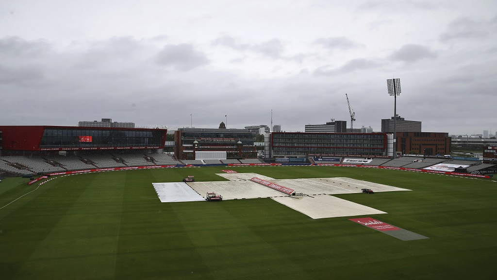 The pitch area is seen covered ahead of the fourth day of the third cricket Test match between England and West Indies at Old Trafford in Manchester, England, Monday, July 27, 2020. (Martin Rickett/Pool via AP)