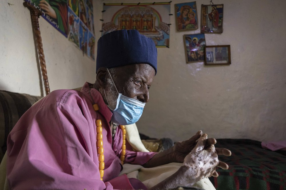 Centenarian Tilahun Woldemichael cries at his house in Addis Ababa, Ethiopia as he prays to God after spending weeks in hospital, recovering from the coronavirus.