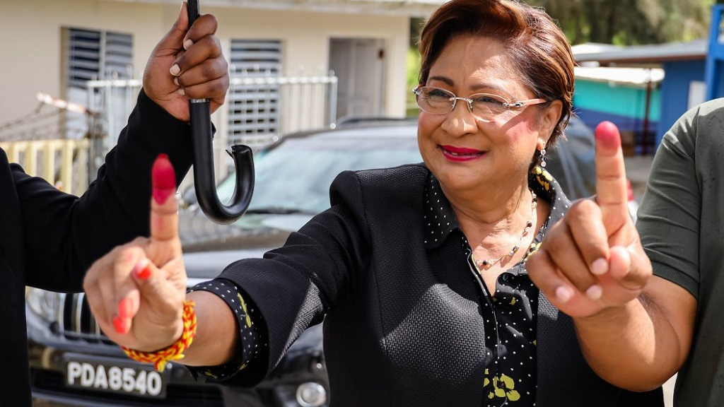 Pictured: UNC leader Kamla Persad-Bissessar holds up her index finger after voting in the 2019 Local Government Election.