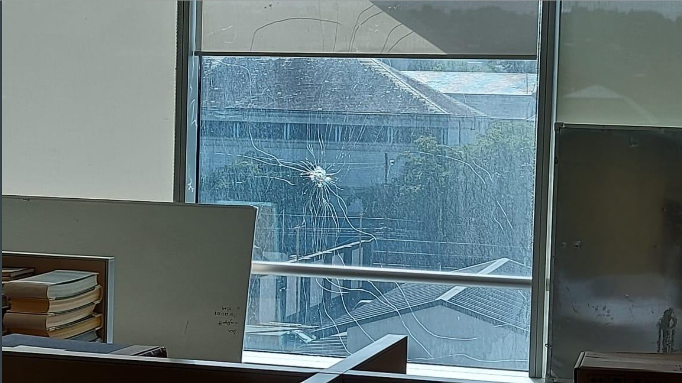 A bullet hole pierced through a window at the AG's office in Port of Spain.