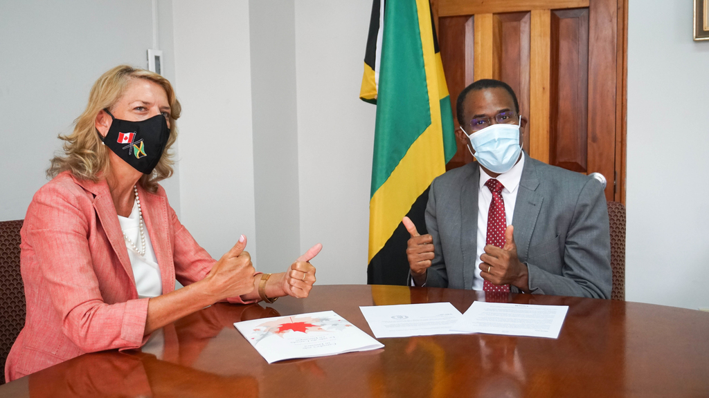 Jamaica's Minister of Finance and the Public Service Dr Nigel Clarke (right), during a courtesy call on Canadian High Commissioner Laurie  Peters.