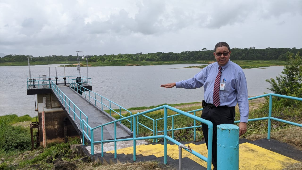 WASA Acting CEO, Alan Poon King shows the dry water line at the Arena Reservoir.