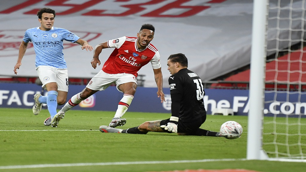 Arsenal's Pierre-Emerick Aubameyang, centre, scores his team's second goal during the FA Cup semifinal match against Manchester City at Wembley in London, England, Saturday, July 18, 2020. (AP Photo/Justin Tallis,Pool).