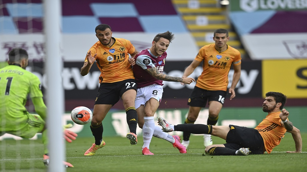 Burnley's Josh Brownhill shoots at goal during the English Premier League football match against Wolverhampton Wanderers at the Turf Moor stadium in Burnley, England, Wednesday, July 15, 2020. (Paul Ellis/Pool via AP).