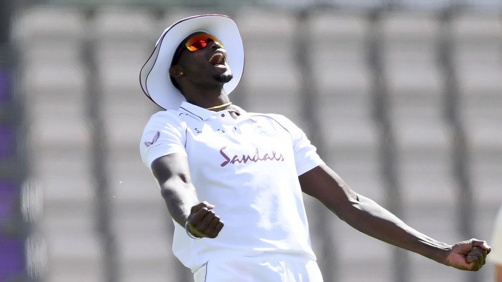 West Indies' captain Jason Holder celebrates after taking the catch to dismiss England's Joe Denly during the fourth day of the first cricket Test match, at the Ageas Bowl in Southampton, England, Saturday, July 11, 2020. (Mike Hewitt/Pool via AP).