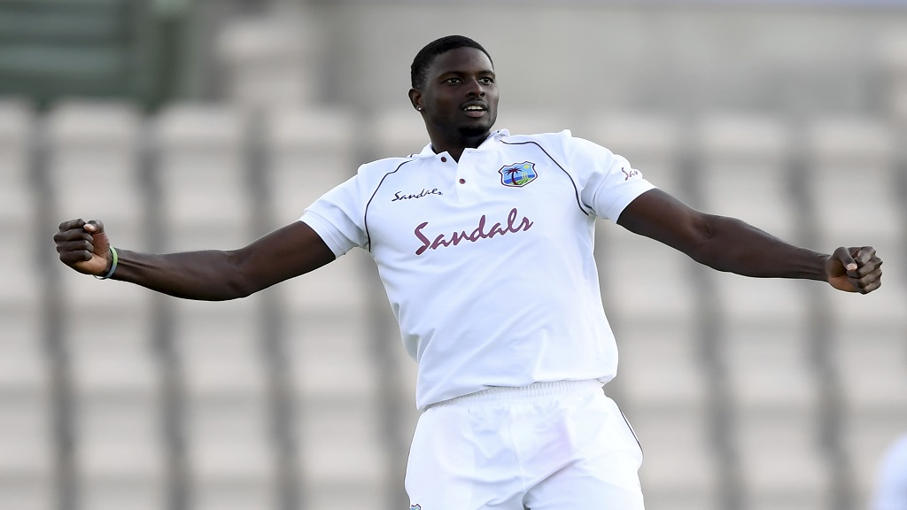West Indies' captain Jason Holder celebrates the dismissal of England captain Ben Stokes during the fourth day of the first cricket Test match, at the Ageas Bowl in Southampton, England, Saturday, July 11, 2020. (Mike Hewitt/Pool via AP).