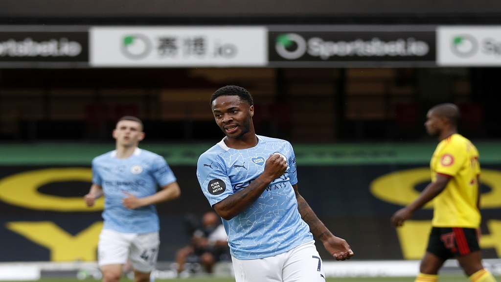 Manchester City's Raheem Sterling celebrates after scoring his side's opening goal during the English Premier League footbsall match against Watford at the Vicarage Road Stadium in Watford, England, Tuesday, July 21, 2020. (Adrian Dennis/Pool via AP).