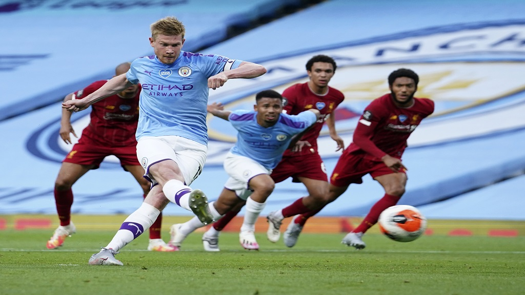 Manchester City's Kevin De Bruyne scores from the penalty spot during the English Premier League football match against Liverpool at Etihad Stadium in Manchester, England, Thursday, July 2, 2020. (AP Photo/Dave Thompson,Pool).