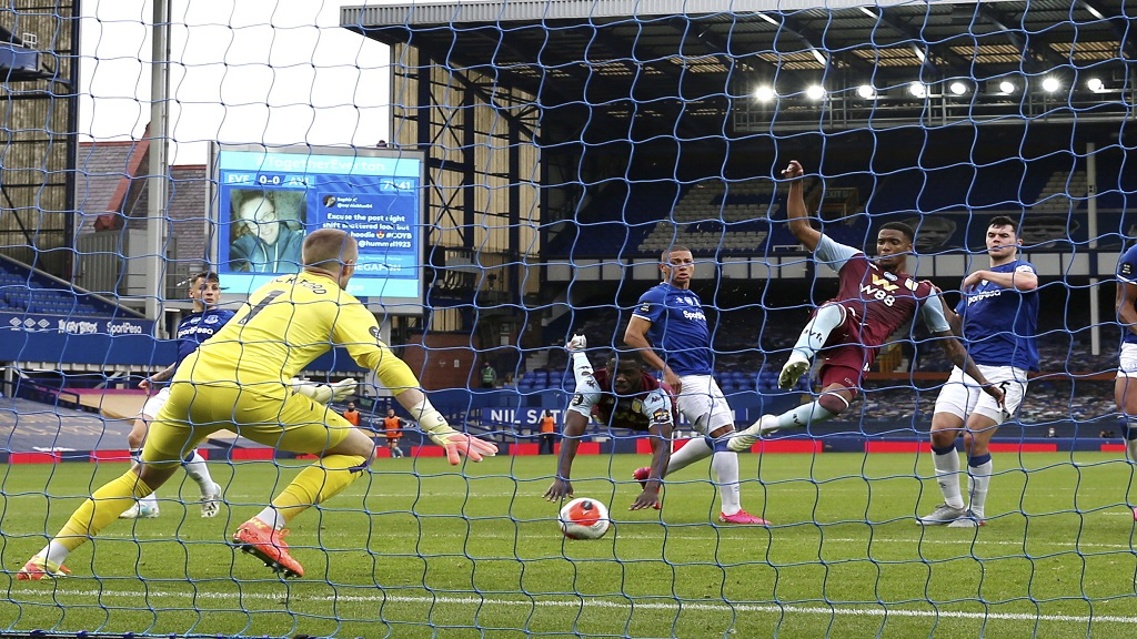 Aston Villa's Ezri Konsa scores during the English Premier League football match against Everton, at Goodison Park in Liverpool, England, Thursday, July 16, 2020. (Clive Brunskill/Pool Via AP).