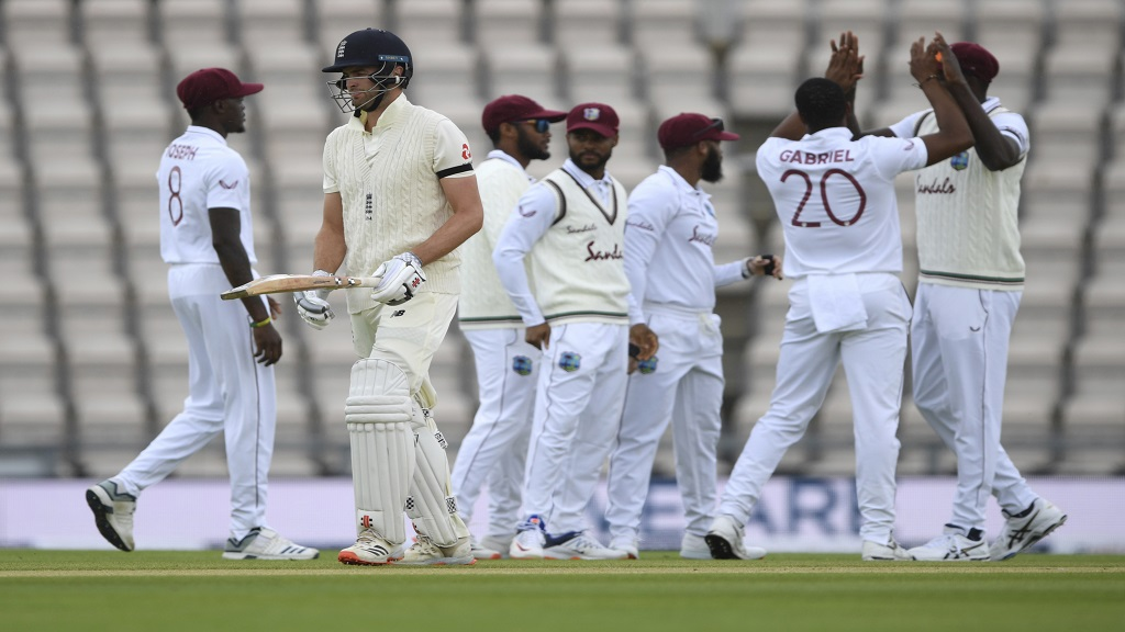 England's Dom Sibley, second left, leaves the field after being dismissed by West Indies' Shannon Gabriel, second right, during the first day of the opening cricket Test match at the Ageas Bowl in Southampton, England, Wednesday July 8, 2020. (Mike Hewitt/Pool via AP).