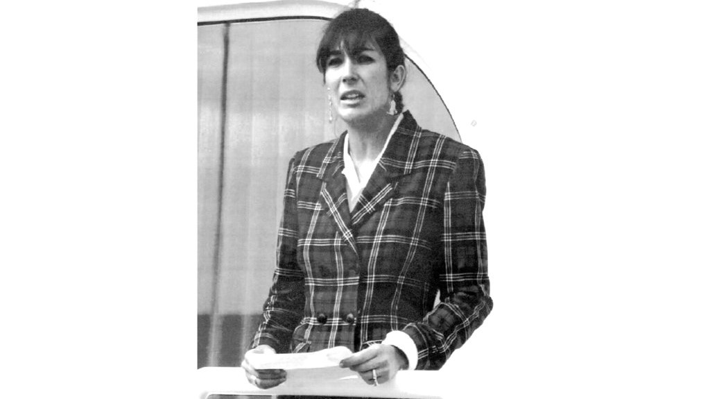 "In this November 7, 1991, file photo Ghislaine Maxwell, daughter of late British publisher Robert Maxwell, reads a statement in Spanish in which she expressed her family's gratitude to the Spanish authorities, aboard the ""Lady Ghislaine"" in Santa Cruz de Tenerife. (AP Photo/Dominique Mollard, File)"