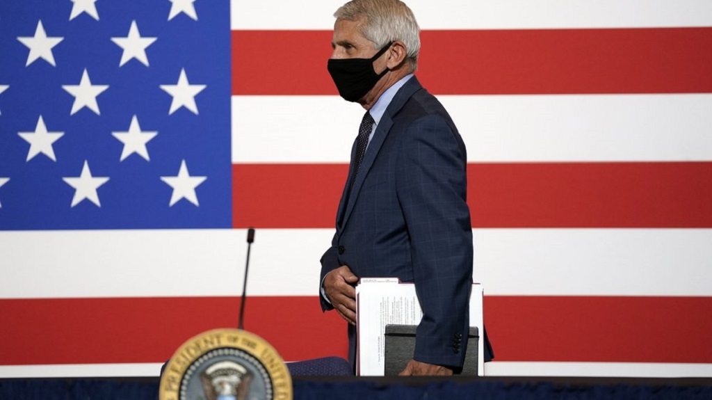Dr. Anthony Fauci, director of the National Institute of Allergy and Infectious Diseases arrives to participate in a roundtable on donating plasma at the American Red Cross national headquarters on Thursday, July 30, 2020, in Washington. (AP Photo/Evan Vucci)