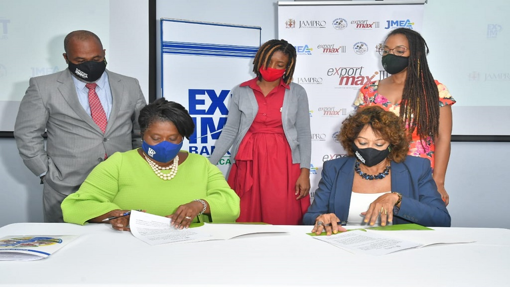 (L-R Seated) Exim Bank Managing Director, Lisa Bell, and Diane Edwards, President of JAMPRO, sign a Memorandum of Understanding (MOU) cementing Exim's sponsorship for export development programme, Export Max III. (L-R Standing) Ricardo Durrant, Manager, Sales and Promotions, Jampro, Melissa Bennett, Manager, Business Advisory Services, JBDC, and Imega Breese McNabb, Executive Director at JMEA look on. The signing took place today, July 30, 2020 at Exim Bank's office in Kingston.