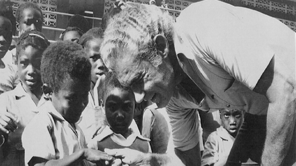 Late former Prime Minister Michael Manley with children during a Labour Day project.