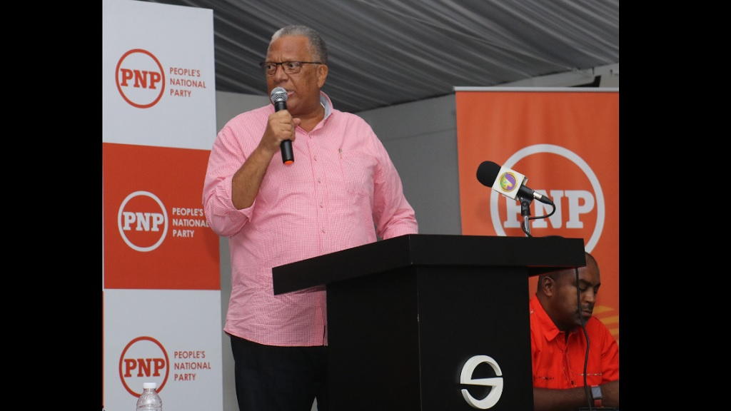 Dr Peter Phillips at a People's National Party (PNP) meeting in Montego Bay, St James on Sunday with the party's councillors and councillor/candidates.
