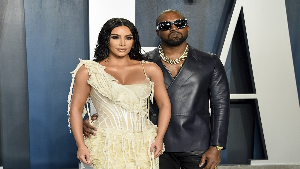 FILE -Kim Kardashian West, left, and Kanye West arrive at the Vanity Fair Oscar Party in Beverly Hills, California on February 9, 2020. (Photo by Evan Agostini/Invision/AP, File)