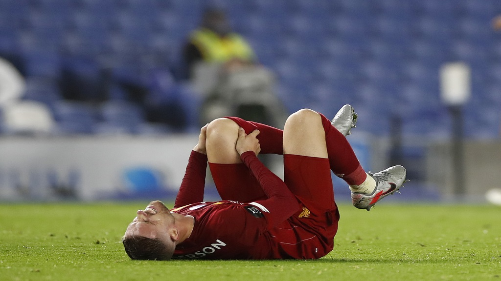 Liverpool's Jordan Henderson reacts during the English Premier League football match against Brighton at Falmer Stadium in Brighton, England, Wednesday, July 8, 2020. (AP Photo/Paul Childs,Pool).