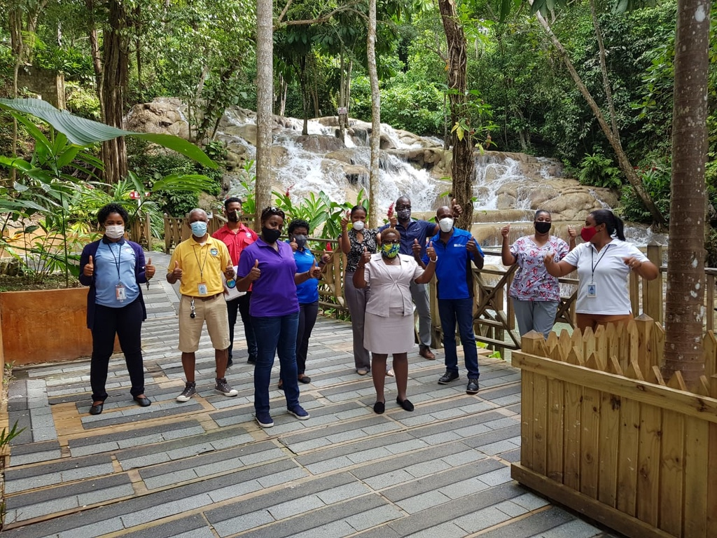 Staff of the world-famous Dunn's River Falls during Tuesday's reopening.