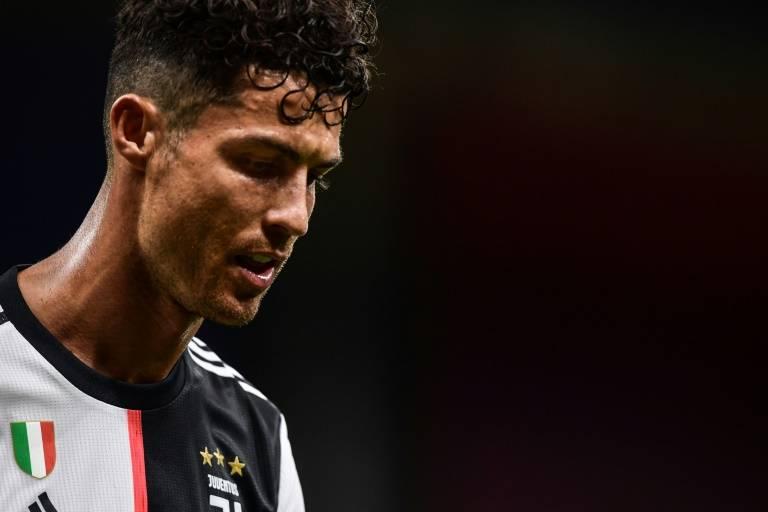 L'attaquant de la Juventus Cristiano Ronaldo après la défaite contre l'AC Milan, le 7 juillet 2020 au stade San Siro de Milan ( AFP / Miguel MEDINA )