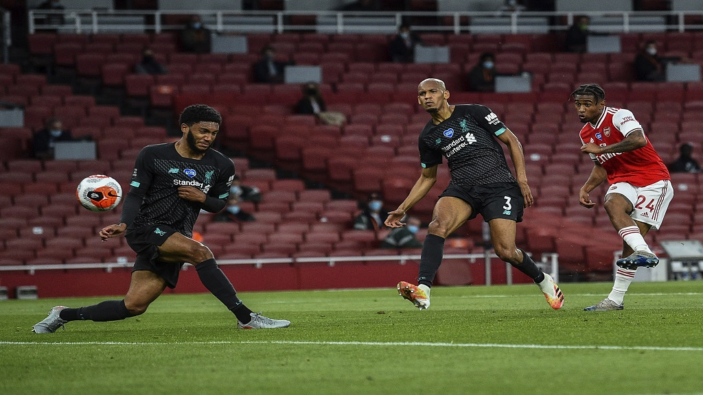 Arsenal's Reiss Nelson, right, scores his team second goal during the English Premier League football match against Liverpool at the Emirates Stadium in London, England, Wednesday, July 15, 2020. (Glyn Kirk/Pool via AP).