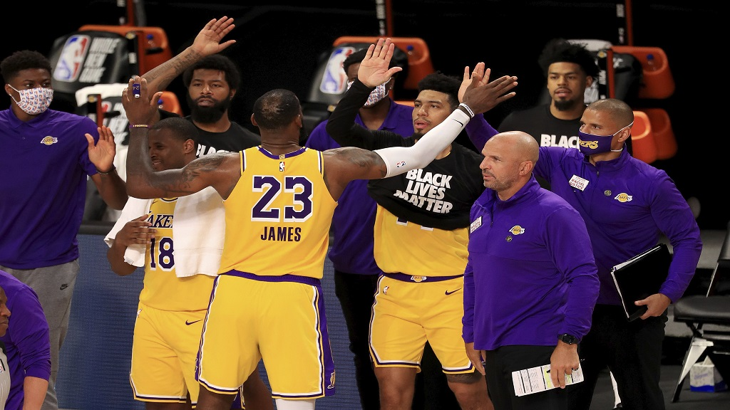 Los Angeles Lakers' LeBron James (23) celebrates with his teammates after they defeated the Los Angeles Clippers in an NBA basketball game Thursday, July 30, 2020, in Lake Buena Vista, Fla. (Mike Ehrmann/Pool Photo via AP).