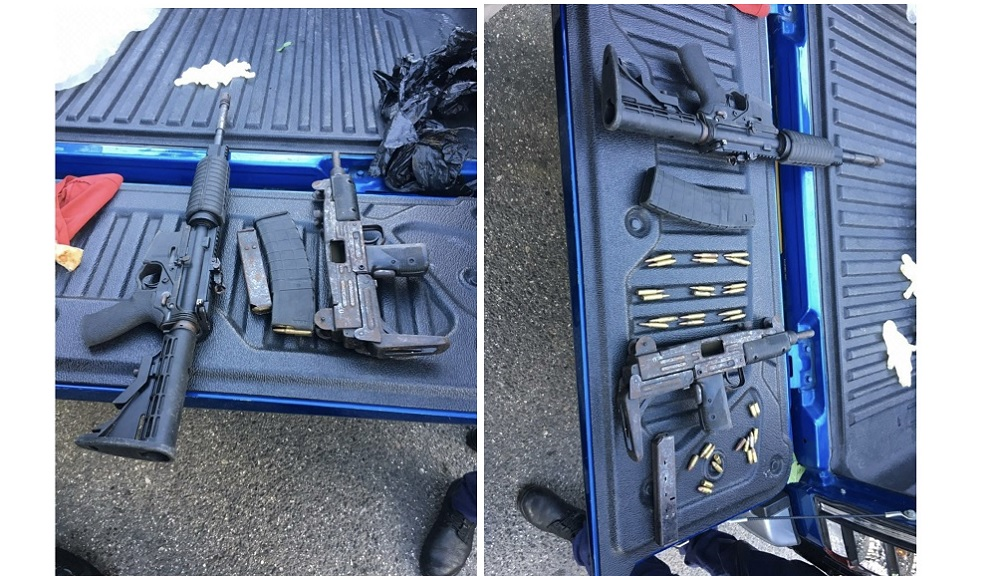 An M16 rifle as well as a 9mm submachine gun were seized in Salt Spring, St James on Friday.