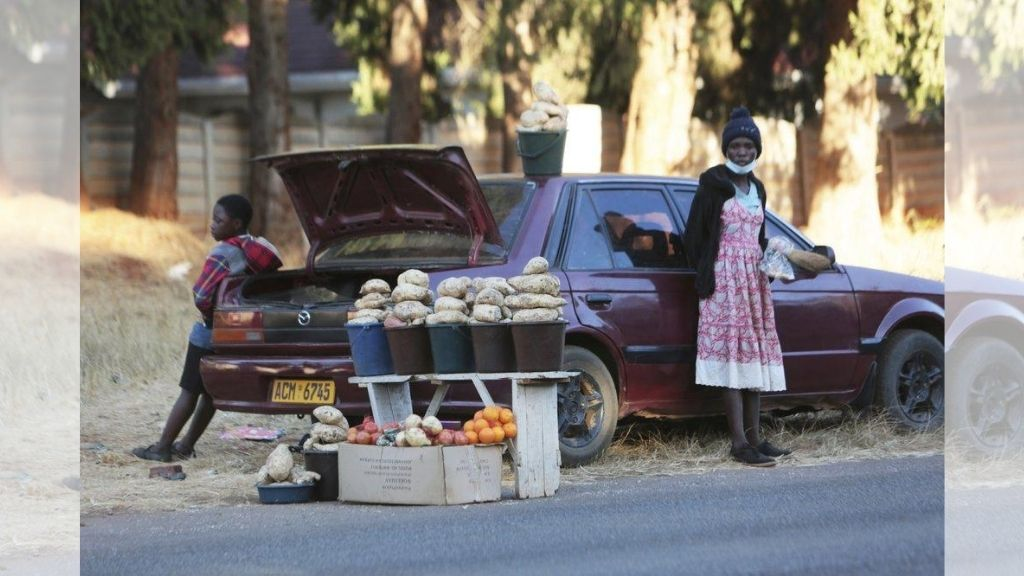 A car displays fruits and vegetables that are sold on a main road in Harare, Zimbabwe. (AP Photo/Tsvangirayi Mukwazhi)