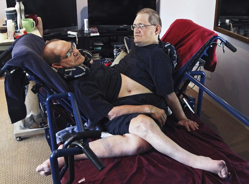 Donnie, left, and Ronnie Galyon sit inside their Beavercreek, Ohio, home, in a Wednesday, July 2, 2014 AP file photo. (Drew Simon/Dayton Daily News via AP, File)
