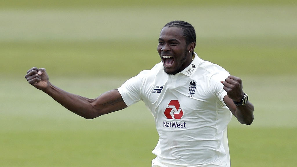 England's Jofra Archer celebrates the dismissal of West Indies' Shamarh Brooks during the fifth day of the first cricket Test match, at the Ageas Bowl in Southampton, England, Sunday, July 12, 2020. (Adrian Dennis/Pool via AP).