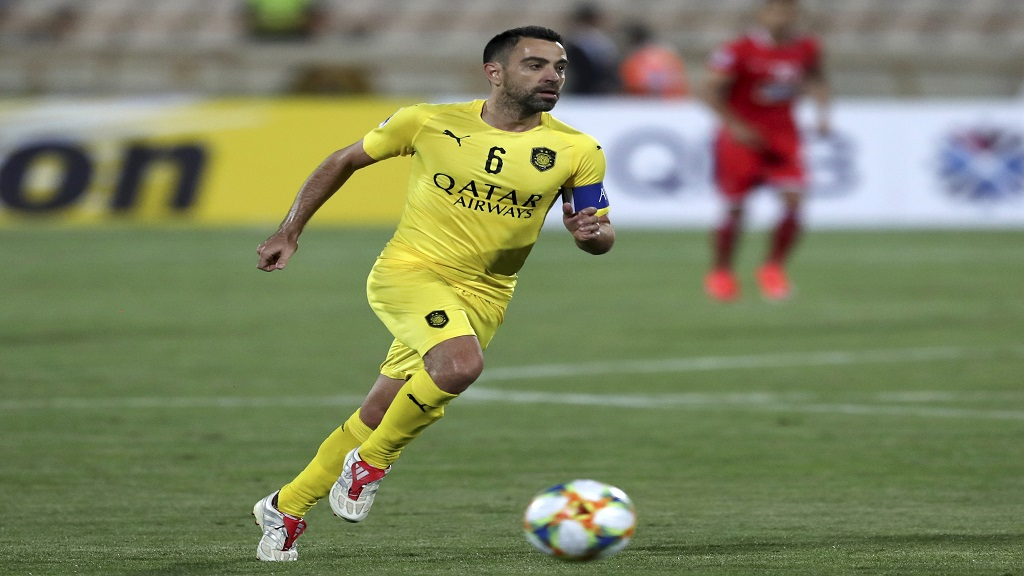 In this file photo dated Monday, May 20, 2019, Qatar's Al-Sadd player Xavi Hernandez, former Barcelona and Spain midfielder, during an AFC Champions League match at the Azadi stadium in Tehran, Iran.  (AP Photo/Vahid Salemi, FILE).