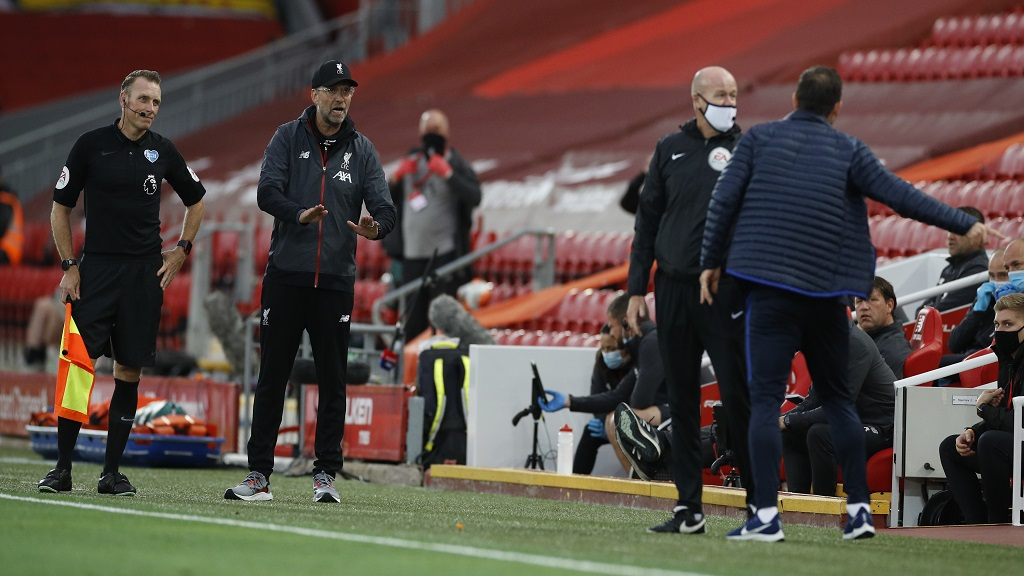 Liverpool's manager Jurgen Klopp, second left and Chelsea's head coach Frank Lampard, right, exchange words during the English Premier League football match at Anfield Stadium in Liverpool, England, Wednesday, July 22, 2020. (Phil Noble/Pool via AP).