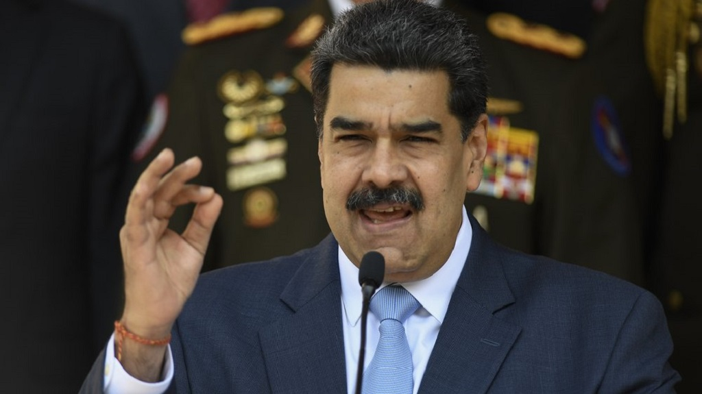 FILE - In this March 12, 2020 file photo, Venezuelan President Nicolas Maduro speaks during a press conference at the Miraflores Presidential Palace in Caracas, Venezuela. (AP Photo/Matias Delacroix, File)