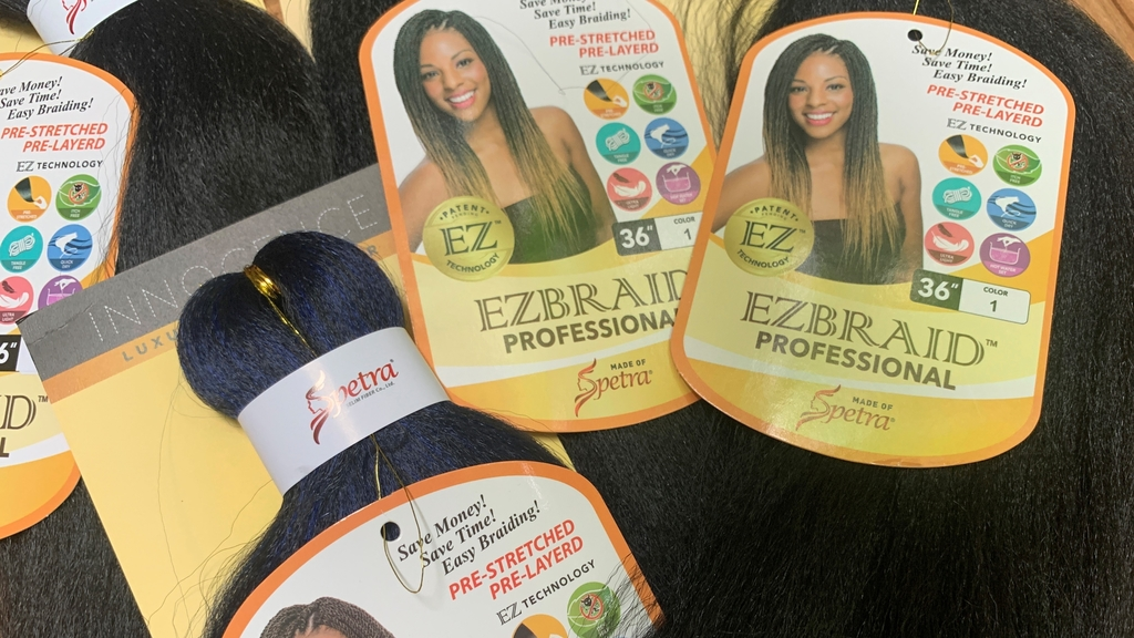 Samples of Pre-stretched Innocence EZBRAND Professional Antibacterial Braid hair extensions from I&I Hair Corporation, purchased in May, are seen in this photo in New York on Wednesday, July 1, 2020.  (AP Photo/Wong Maye-E)