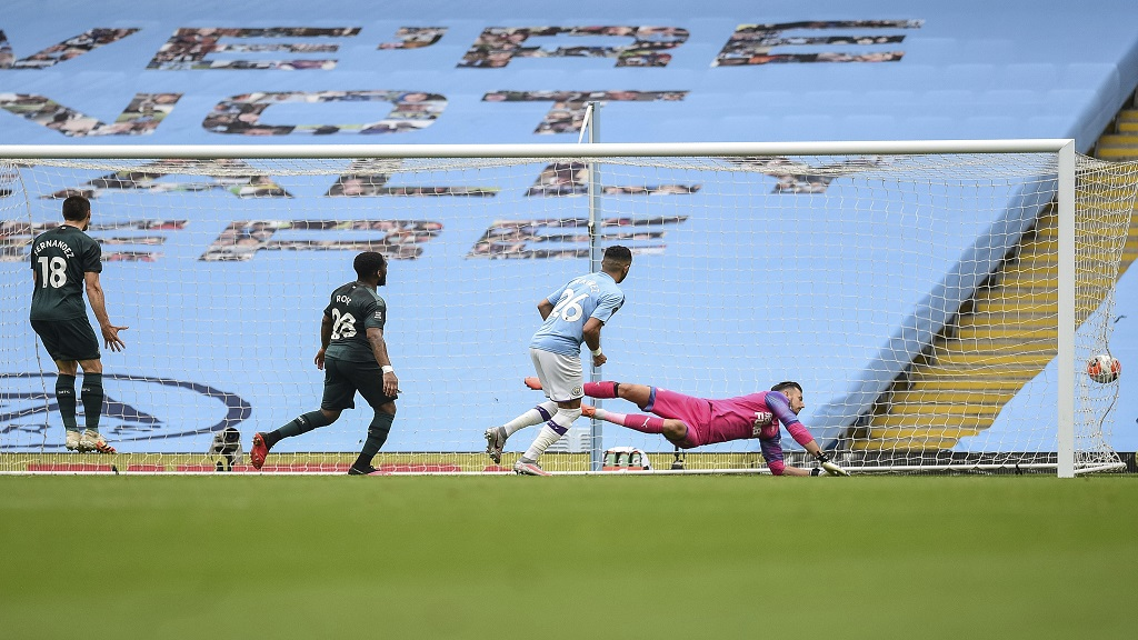 Manchester City's Riyad Mahrez, second right, scores during the English Premier League football match against Newcastle at the Ethiad Stadium in Manchester, England, Wednesday, July 8, 2020.(Oli Scarff/Pool via AP).