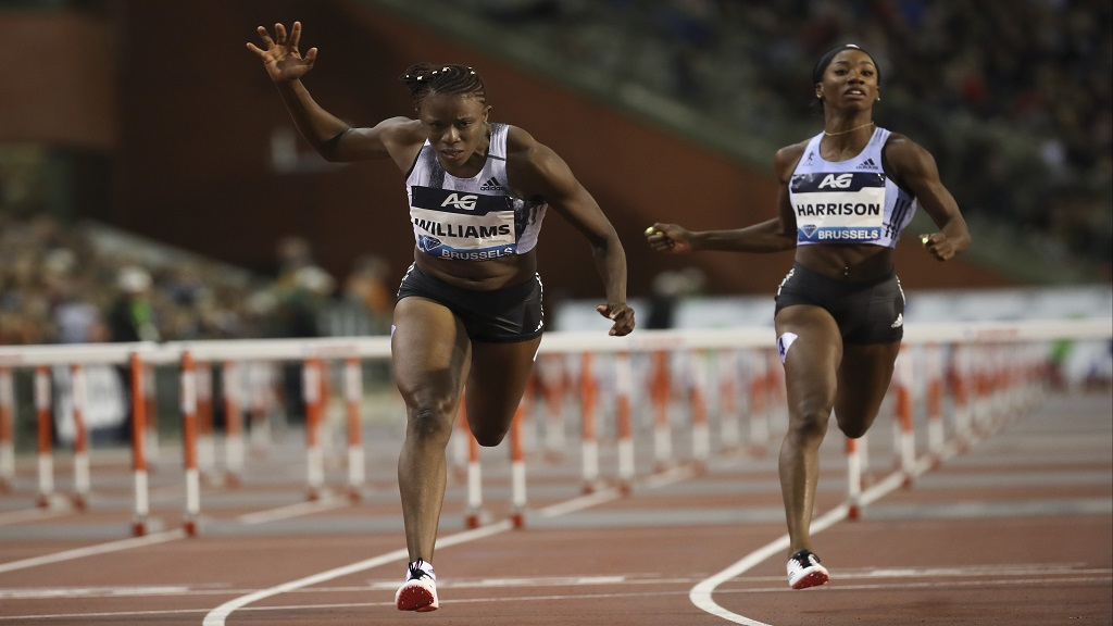 Jamaica's Danielle Williams, left, wins the women's 100m hurdles during the Diamond League Memorial Van Damme athletics event at the King Baudouin stadium in Brussels, Friday, Sept. 6, 2019. (AP Photo/Francisco Seco).