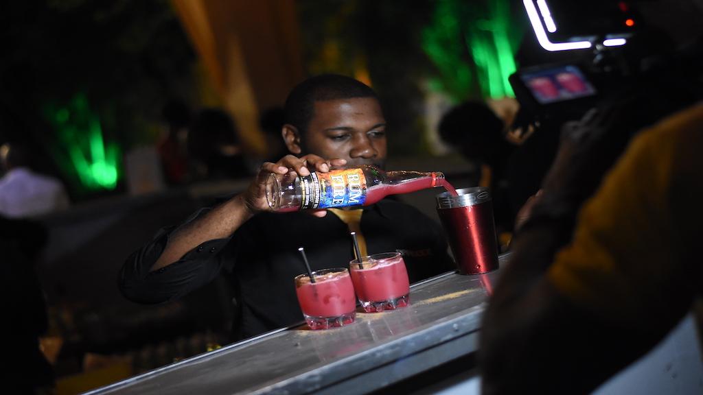 Popular bartender Craig Wilson whips up a signature Rum Fire cocktail. (Photos: Marlon Reid)